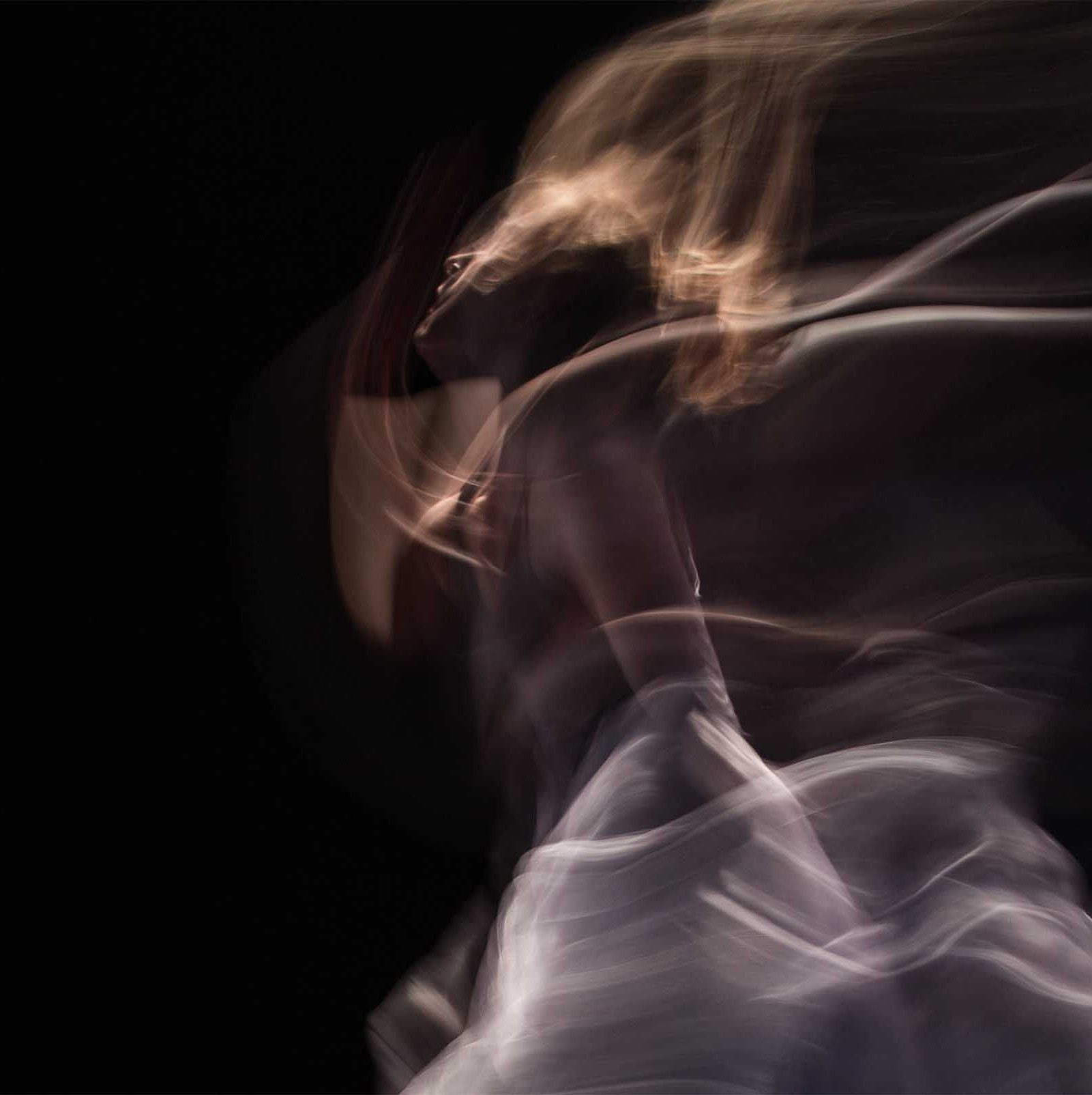 A blurred arty picture of a dancer on a black background